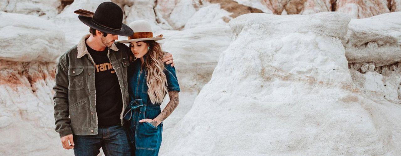 man and women wearing Wrangler clothing